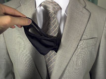 Morning question 3. Woman's hand pulls a girl's pants out of the man's suit pocket (Morning question 3 Stock Photo