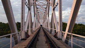 Morning on the railway bridge. Metal structures and nature.  stock footage