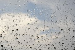 Morning rain, drops of water on a window glass background, copy space.  Royalty Free Stock Photo