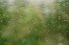 Morning rain, drops of water on a window glass background, copy space.  Royalty Free Stock Images