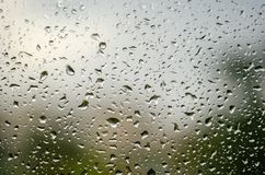 Morning rain, drops of water on a window glass background, copy space.  Stock Photos