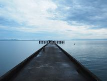 The morning after the rain in pier. stock photos