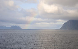 Morning rainbow above Norwegian fjord Stock Photography