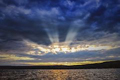Morning rays. Crepusculars on keuka Royalty Free Stock Images