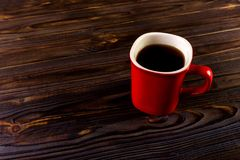 Morning red coffee cup at wooden background Royalty Free Stock Photo