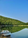 Morning reflection. Fishing Boat on the lake Kamchia Royalty Free Stock Photography