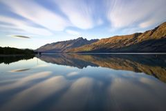 Morning reflection. Reflection of the clouds in the morning on a lake in New Zealand Royalty Free Stock Photos