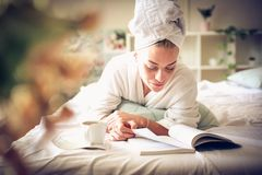 Morning relax. Young woman at morning routine. stock photo