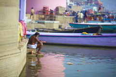 Morning ritual washing meditation in India. Morning ritual washing meditation by the river Ganges in Varansi royalty free stock photography