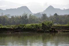 Morning on the river bank. In Lao Stock Image