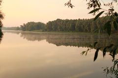 Morning on the river. Fog and evaporation over water. stock photos