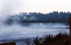 Morning river mist. The bridge, the river, fog, morning Stock Image