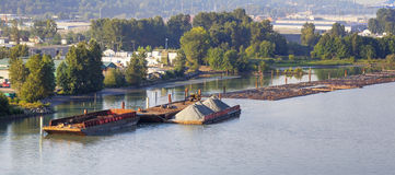 Morning riverside view with barges and logs Royalty Free Stock Photography
