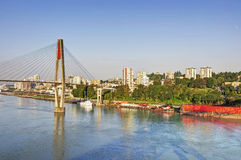 Morning riverside view of a city by a river Royalty Free Stock Photography