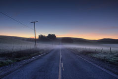 Morning Road. Early sunrise on empty road Royalty Free Stock Image