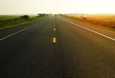 Morning on the road. With yellow lines Stock Photos