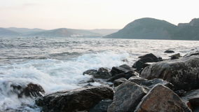 Morning rocky sea shore stock footage