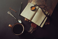 Morning of romantic person. Photo of a cup of coffee and a notebook with a pen Stock Photo