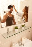 Morning routine in bathroom Royalty Free Stock Image
