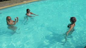 Morning routine exercises in the pool water in a resort stock video
