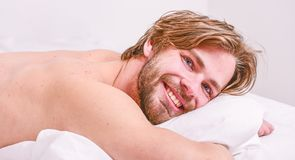 Morning routine tips to feel good all day. Man handsome guy lay in bed in morning. Tips on how to wake up feeling fresh royalty free stock photos