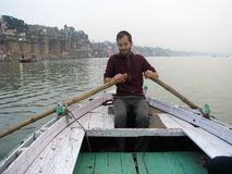 Morning rowing on Ganges. Rowing a boat on the Ganges river in Varanasi, India Royalty Free Stock Photography