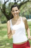 Morning Run. An attractive woman running in the park stock photos