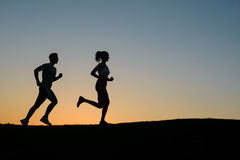 Morning run on the nature. Guy runs on the evening meadow. Sports jogging outdoors. Running sports Royalty Free Stock Image