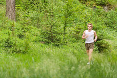 Morning run: Young man jogging in nature Royalty Free Stock Photos