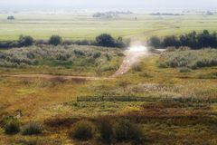 Morning rural landscape with road. Crossing the field and the river stock photography