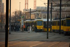 Morning rush hour in Berlin. Berlin, Germany, March 03, 2011: Alexanderplatz square, yellow electric tram stop - lot of people people coming in and out of car in Royalty Free Stock Photos