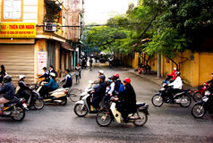 Morning rush hour, Hanoi, Vietnam. Commuters riding motorcycles and scooters to work during the morning rush in Hanoi, Vietnam Stock Image