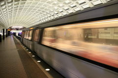 Morning rush on the subway, Washington, DC, 2017. Platform in front of speeding subway, with intricate detail of ceilings above, Washington, DC, 2017 Royalty Free Stock Image