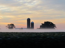 Morning Scene. Fresh fog below the farm home scenery Royalty Free Stock Images