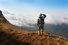 Man at landscape of high mountain Royalty Free Stock Photography