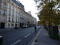 Street of Paris showing buildings and road royalty free stock image