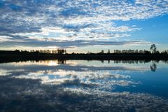 Morning scenery with clouds and sky reflecting surface. Morning scenery with clouds and sky reflects the river surface Royalty Free Stock Photos