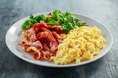 Morning Scrambled egg, bacon breakfast on white plate Stock Photography