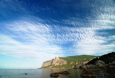 Morning in a sea bay with amazing sky and clouds Royalty Free Stock Photos