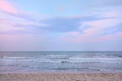 Morning on sea, Beautiful nature blue sky with clouds. Colorful sky as a background. Soft wave of the sea on the sandy beach at Cha-am beach, Thailand. Space Royalty Free Stock Photography