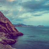 Morning seascape with mountains Stock Images