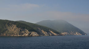 Morning seaview on Elba Island rocky cliffs Royalty Free Stock Photos