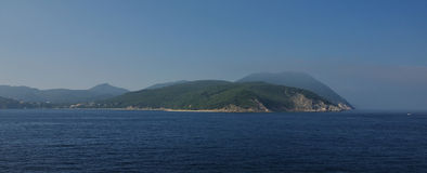Morning seaview on Elba Island rocky coast Stock Photography