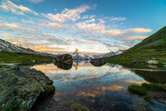 Morning shot of the Matterhorn Monte Cervino, Mont Cervin pyramid and Stellisee lake. royalty free stock photography