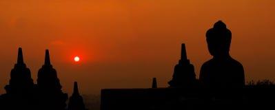 Morning silhouette of Buddha image on Borobudur temple,Yogyakart Stock Photos
