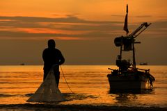 Morning Silhouetted Fisherman work Royalty Free Stock Image