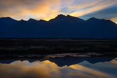 Morning Sky Behind The Mountains. Sunrise behind the Montana Mountains with beautiful reflection in the lake Stock Photo