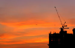 Morning sky and building. Building and plane in the morning sky  orange color background Royalty Free Stock Photos