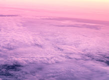 Morning sky and clouds from above. Sky and clouds image taken form above while flying in a plane Stock Photo