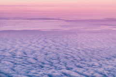 Morning sky and clouds from above. Sky and clouds image taken form above while flying in a plane Stock Images